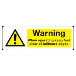 When operating keep feet clear of tailboard edges sign