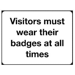 Visitors must wear their badges at all time Sign