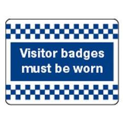Visitors badges must be worn Sign