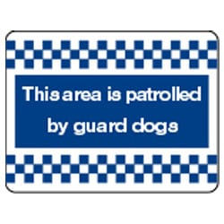This area is patrolled by guard dogs Sign