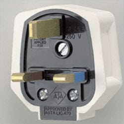 White rubber plug with a 13 amp fuse